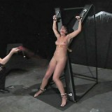AVN award winner Penny Flame is chained in the dimly lit room as she frantically looks for escape.
